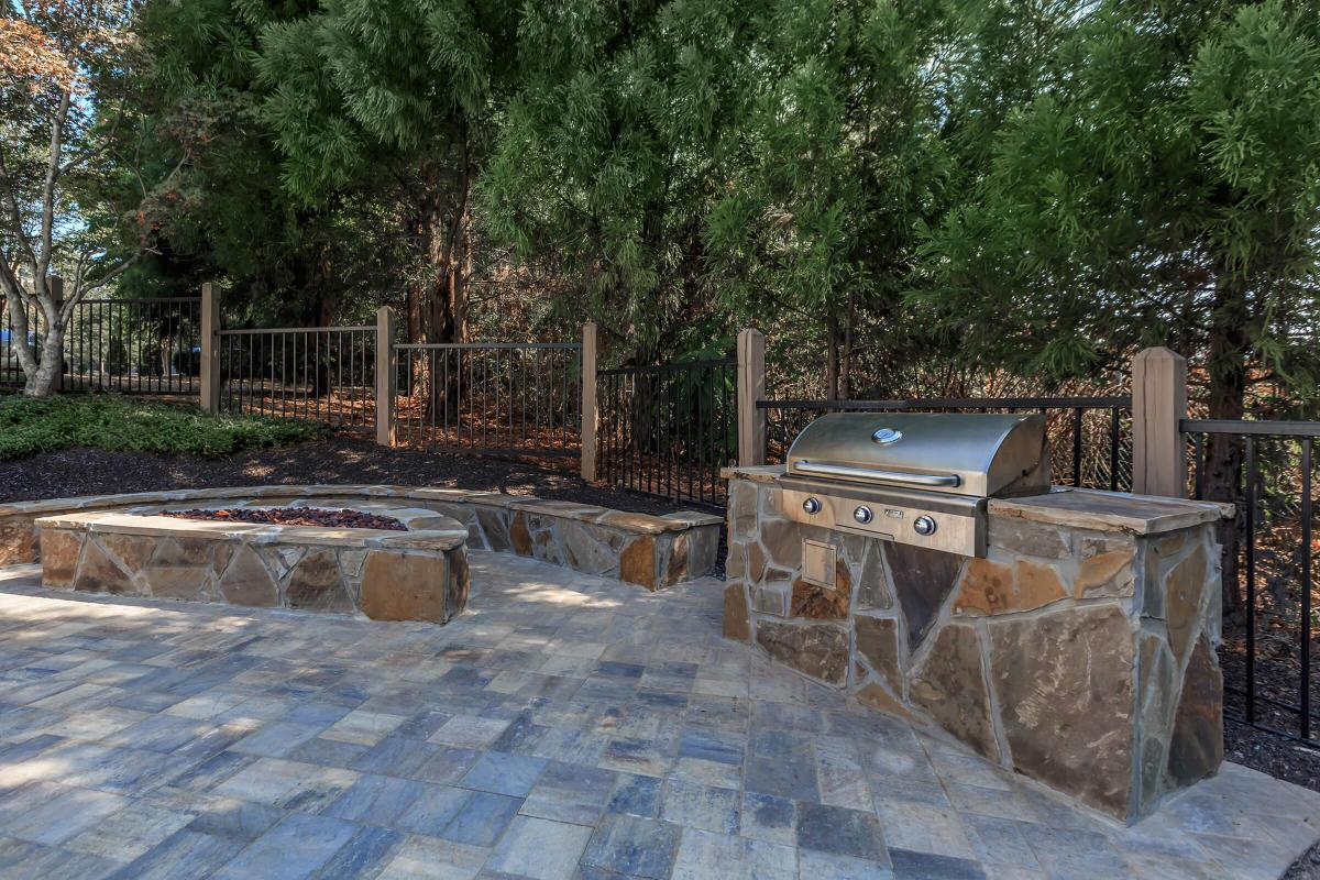 New Fire Pit and Gas Grills by the Pool at Laurel Ridge Apartments in Chattanooga, Tennessee