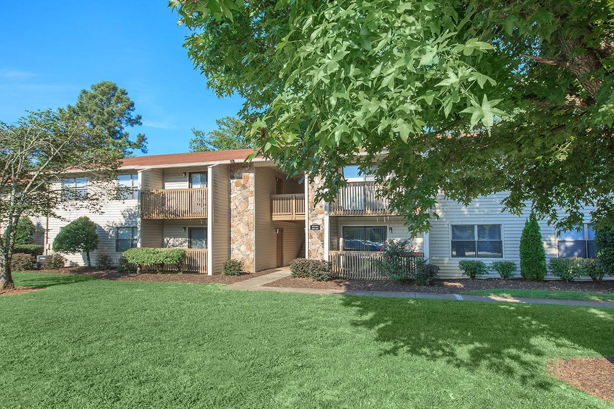Lush grass landscaping and mature trees surrounds Laurel Ridge Apartments