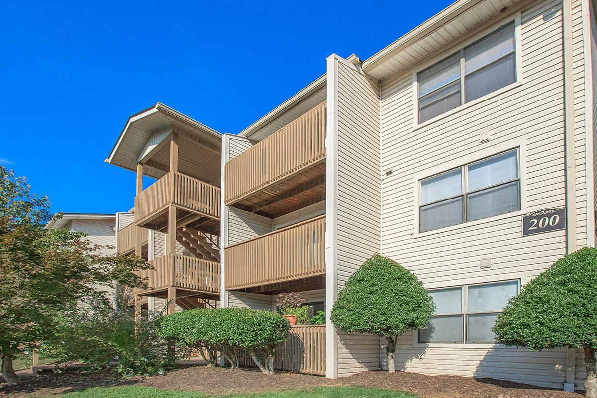 The Laurel Ridge Apartments Three Story Building with Balconies and Patios