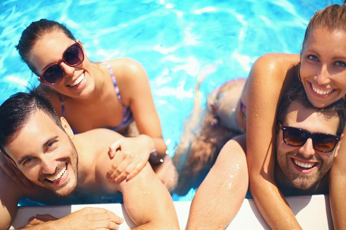 People enjoying the shimmering swimming pool