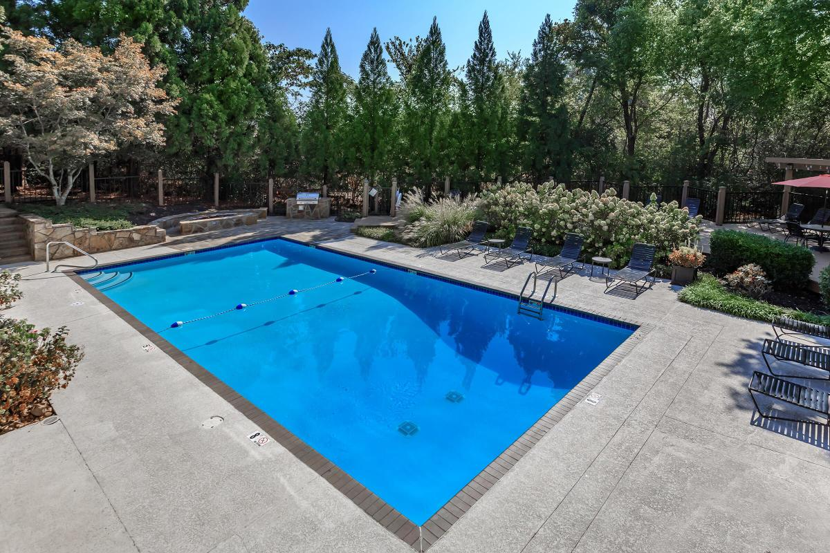 Swimming Pool Surrounded by Gorgeous Landscaping at Laurel Ridge Apartments in Chattanooga