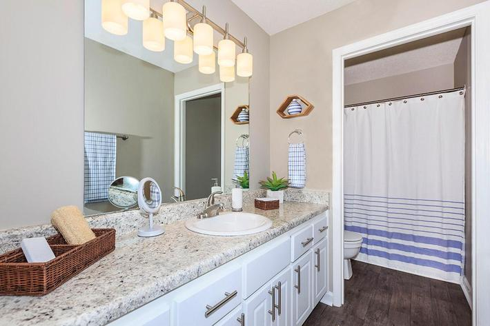 Sleek Bathroom Countertops Here at The Magnolia at Laurel Ridge Apartments in Chattanooga, Tennessee