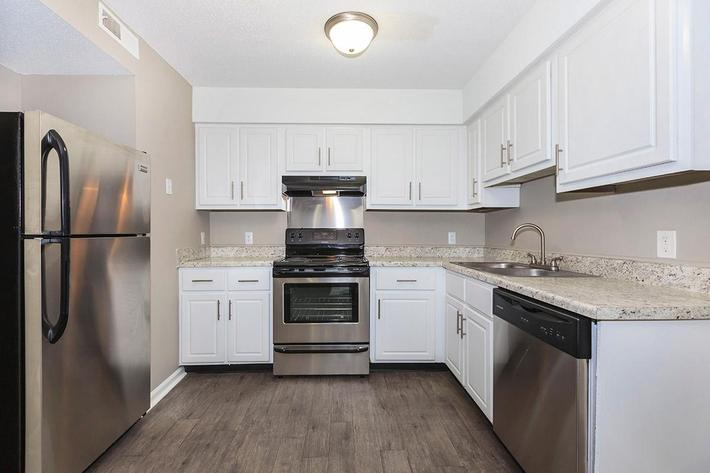 STAINLESS STEEL APPLIANCES IN KITCHENS AT LAUREL RIDGE APARTMENTS