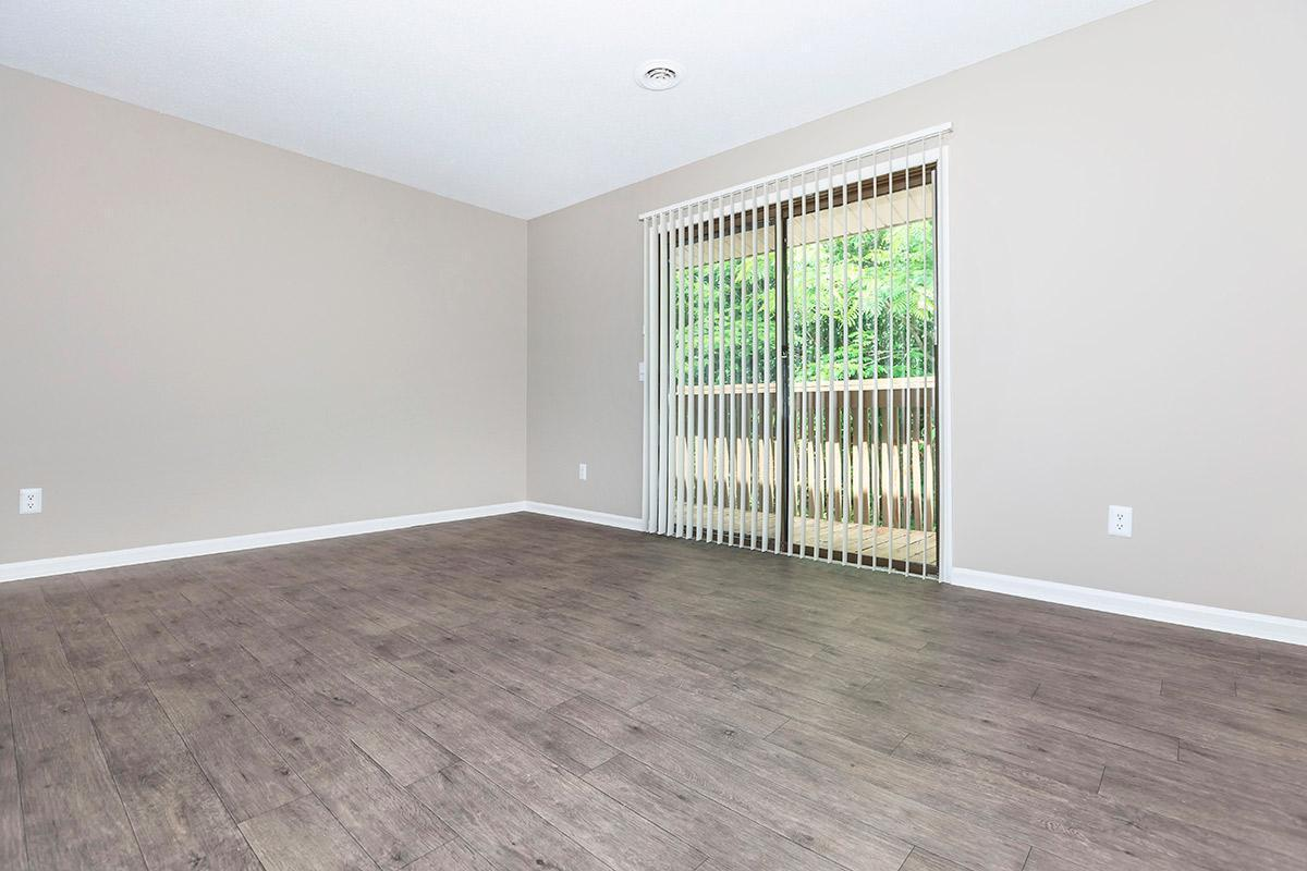 Vertical Blinds and Hardwood Floors in the Willow at Laurel Ridge Apartments