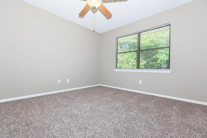One Bedroom Willow Has a Lighted Ceiling Fan