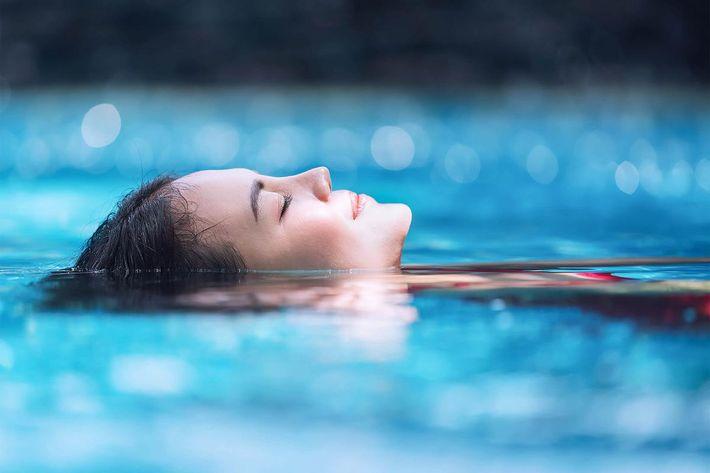 Relaxing in swimming pool iStock-856857146.jpg