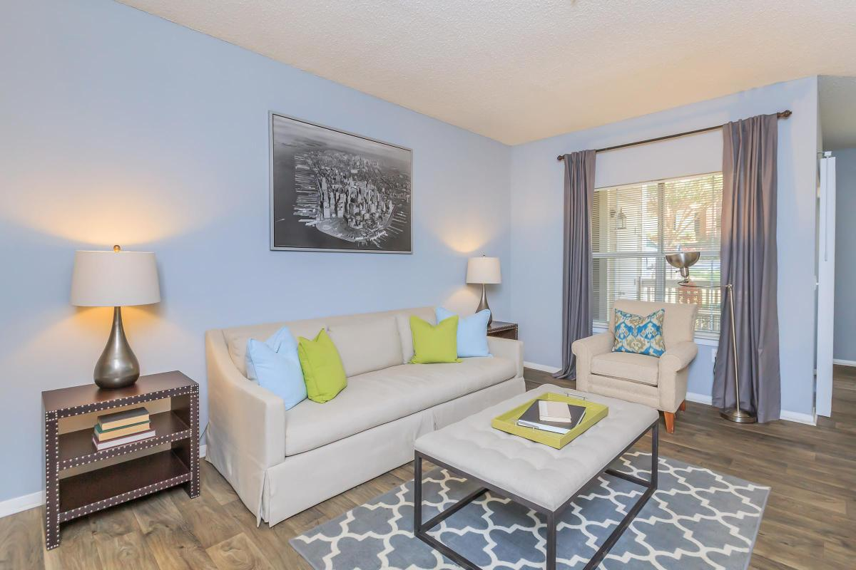 YOUR NEW LIVING ROOM AT WATERFORD HILLS APARTMENTS