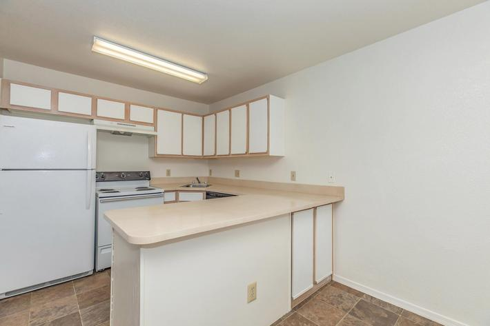 Dishwasher and refrigerator at La Posada apartments for rent