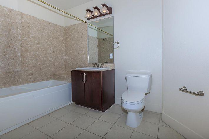 TILED BATHROOMS WITH DESIGNER FIXTURES AT ECHELON AT CENTENNIAL HILLS IN LAS VEGAS