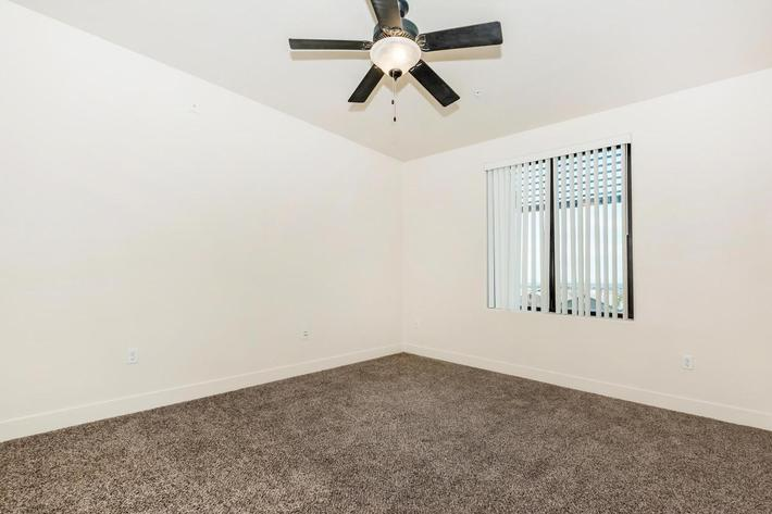 ECHELON AT CENTENNIAL HILLS IN LAS VEGAS HAS CEILING FANS AND CARPETED FLOORS