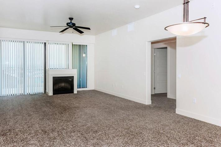 FIREPLACE, CEILING FANS, AND CARPETED FLOORS AT ECHELON AT CENTENNIAL HILLS IN LAS VEGAS