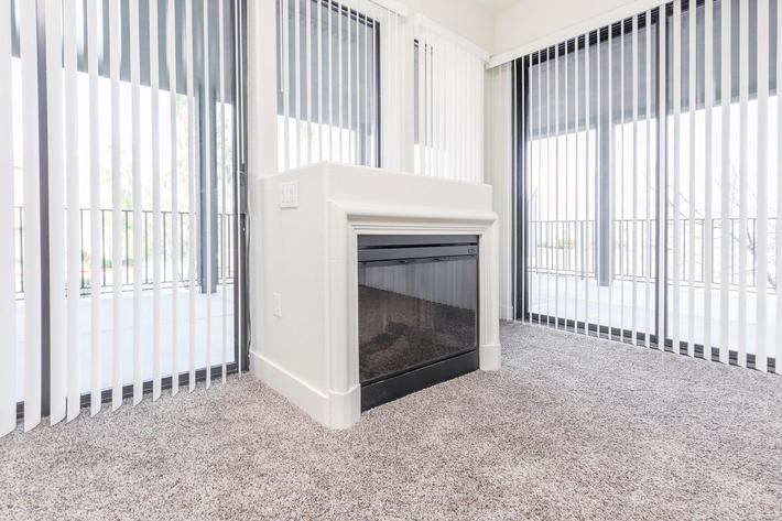 ECHELON AT CENTENNIAL HILLS IN LAS VEGAS HAS CARPETED FLOORS, VERTICAL BLINDS, AND GAS FIREPLACES