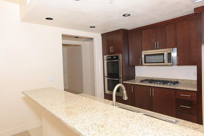 ECHELON AT CENTENNIAL HILLS IN LAS VEGAS HAS GRANITE COUNTERTOPS AND STAINLESS STEEL APPLIANCES