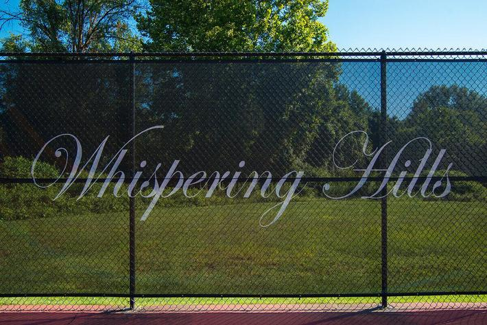 Whispering Hills Apartments in Creve Coeur, MO - Tennis Court 02.jpg