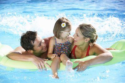 family having fun in the swimming pool.jpg