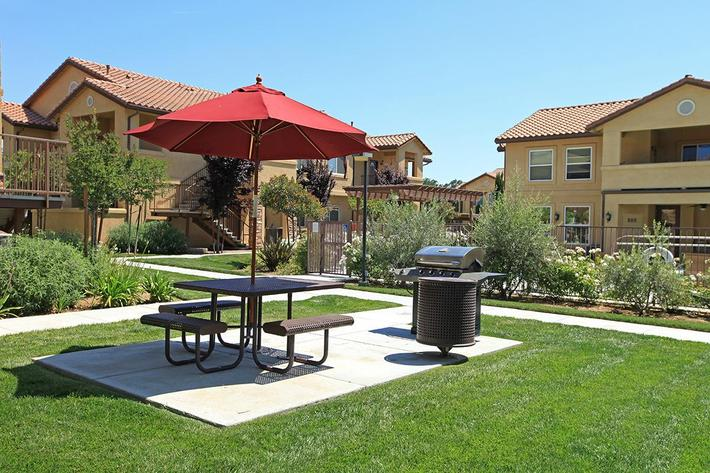 Enjoy the picnic area with barbecues at Villa Siena Apartments