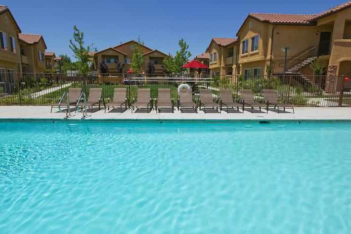 Relax by the pool in Villa Siena Apartments