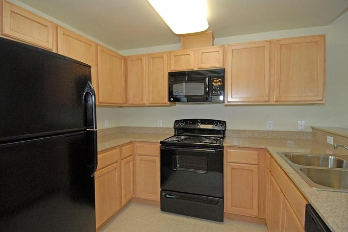 Villa Siena Apartments provides well-equipped kitchens