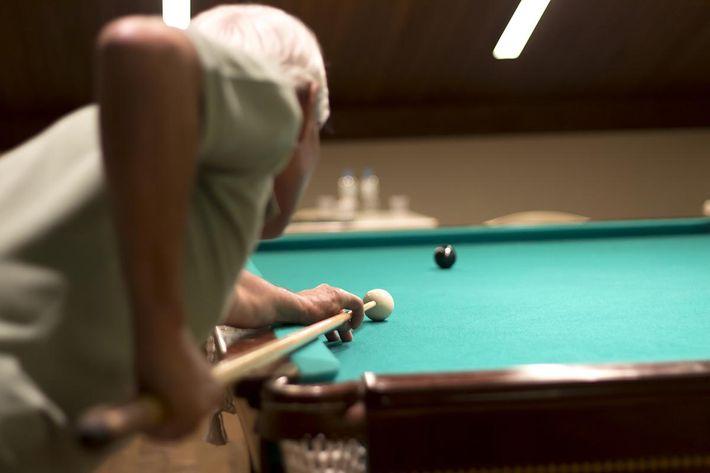 Senior man playing pool.jpg