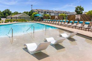 a pool next to a beach