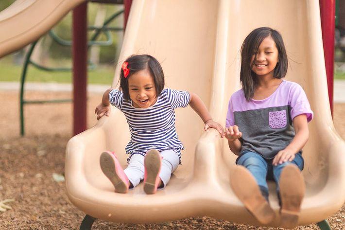 girls on slide iStock-899820580.jpg