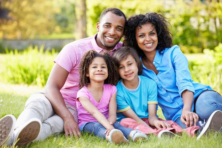 African American Family Sitting In Garden iStock_31635434_LARGE.jpg