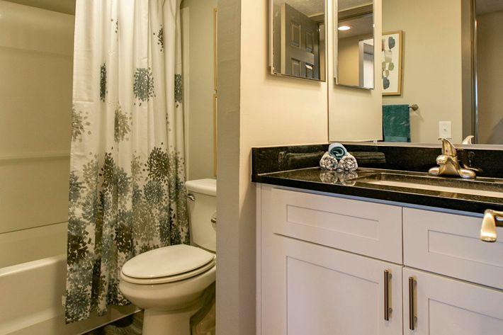 Runaway Bay renovated bathroom commode and sink.jpg