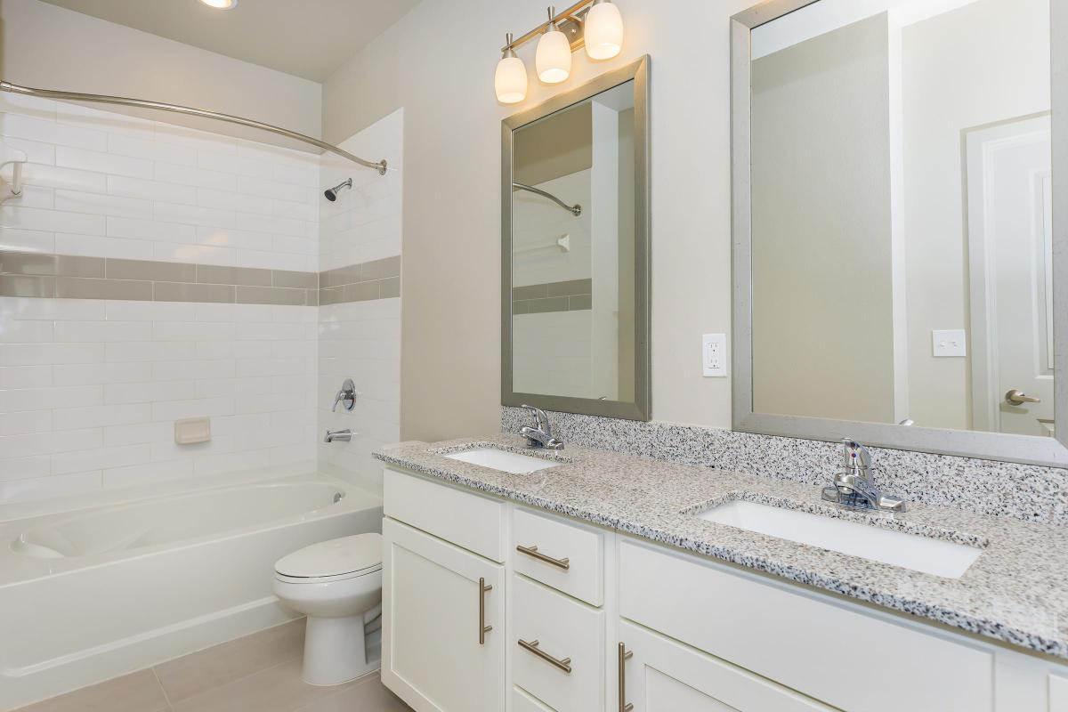 Sleek bathrooms at Ariza Gosling in Spring, Texas