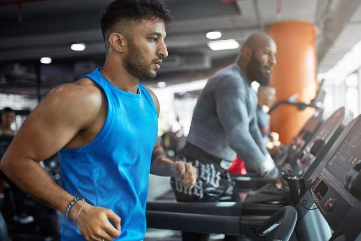 Ethnic-Man-Treadmill-Fitness-Gym-1060199488.jpg