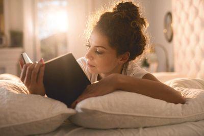 interior-bedroom-woman reading in bed.jpg