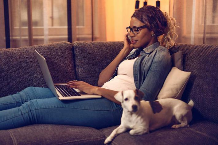 Woman with Dog on Couch-iStock_89295865.jpg
