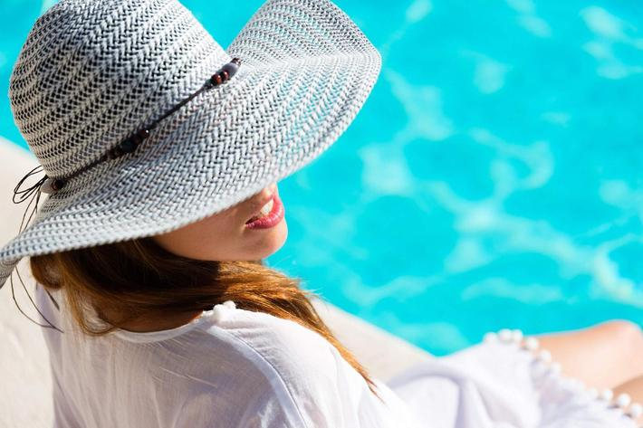 woman relaxing at poolside iStock-516652390.jpg
