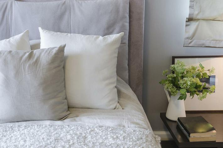white pillows on white bed.jpg
