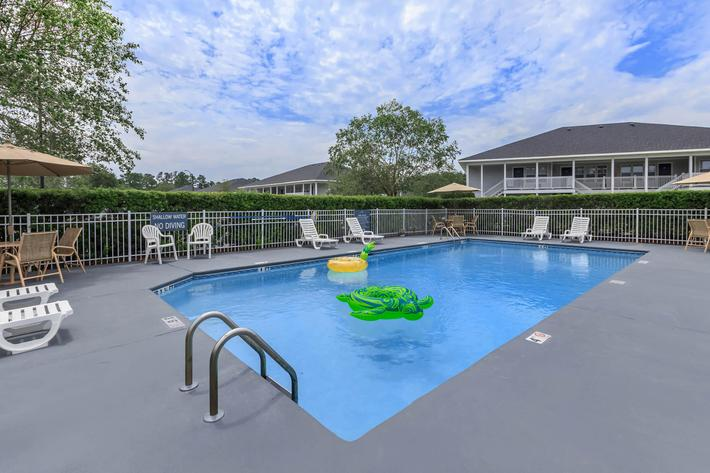 Soak up the sun in the shimmering swimming pool at Windsor Place in Jacksonville, NC.