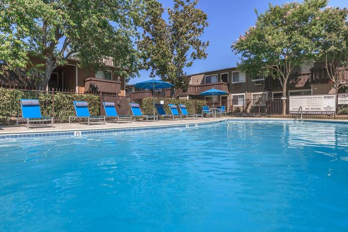 Relax by the pool at Thornbridge Apartments