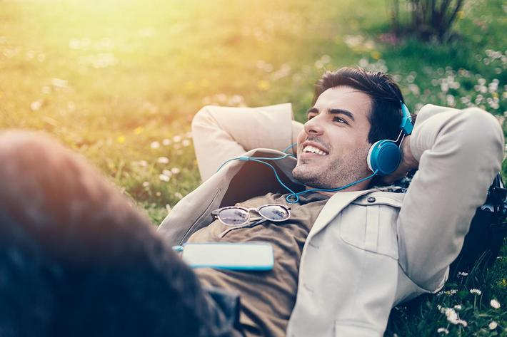amenities-outdoor-Young man laying on grass.jpg
