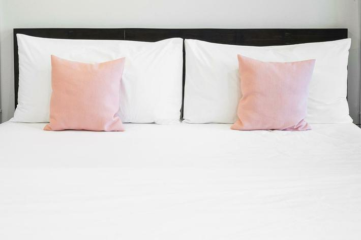 Bed and pink pillows.jpg