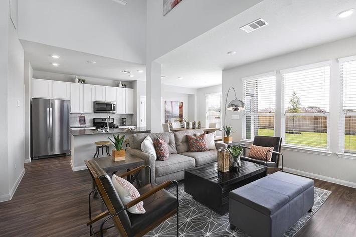 Apartments for Rent in Georgetown - Rivers Edge Bright and Airy, Open-concept Living Room with Multiple Large Windows and Wood Flooring