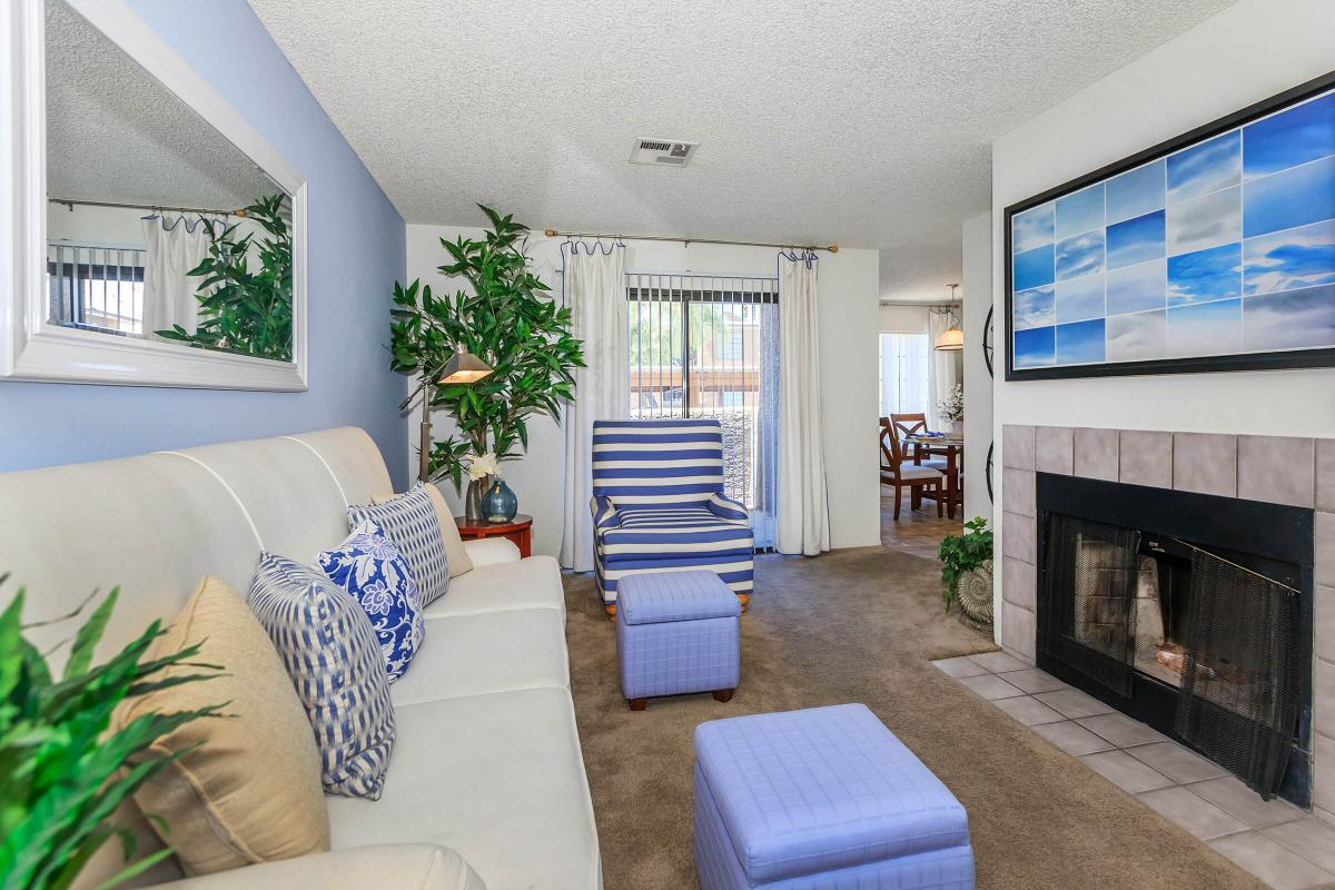 YOUR NEW LIVING ROOM WITH A FIREPLACE AT CANYON CREEK VILLAS IN LAS VEGAS, NEVADA