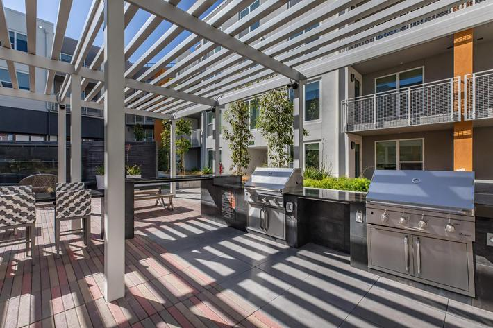 OUTDOOR KITCHEN, GRILLING AREA & GAMES