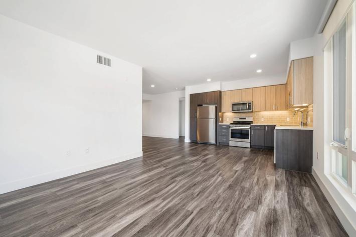 WOOD PLANK FLOORING AND STAINLESS STEEL APPLIANCES