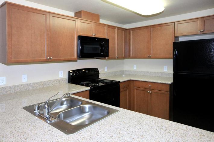 Greystone Apartments provides beautiful cabinetry in their kitchens