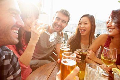 Group Of Friends Enjoying Drink At Outdoor Rooftop Bar iStock-478503875.jpg