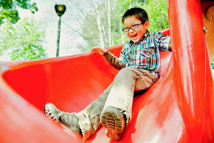 boy on red slide iStock-182747708.jpg