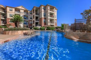 SHIMMERING SWIMMING POOL AT BAY VISTA IN CORPUS CHRISTI, TX