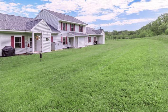 a house with a grass field