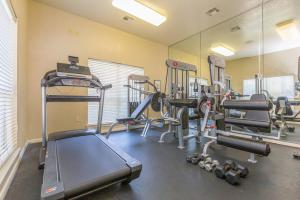 Fitness center with quality equipment in front of mirror in The Avenue apartments for rent