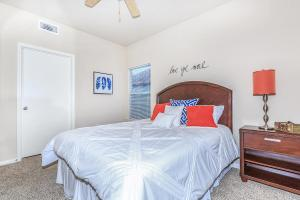 Furnished bedroom with ceiling fan