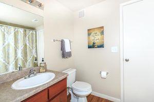 Bathroom with sink, toilet, and towel rack