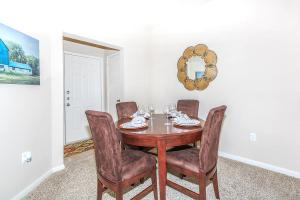 Apartment dining area with four wine glasses and place settings